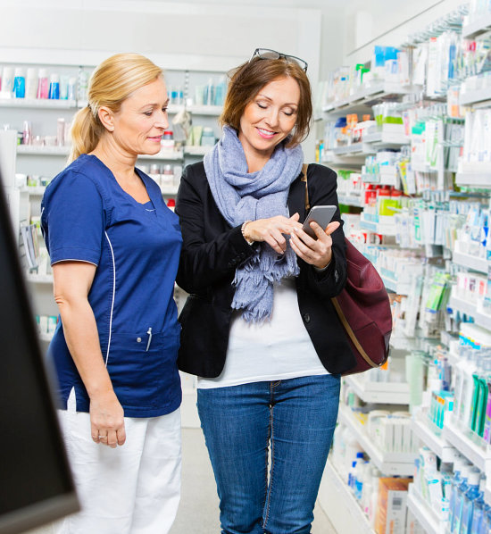 pharmacist assisting her customer